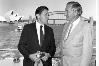 Then US secretary for defence Caspar Weinberger chats with Senator Sir John Carrick in 1982.
