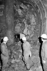 Workers inspect a hole in the tunnel linking Parliament Station to Jolimont Station.
