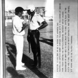 Scan from AP radiogram image in the Fairfax Archive. Bob Simpson taking with a policeman at Sabina Park, May 3, 1978.