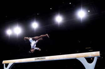 Biles in action on the balance beam during her all-around world title win.