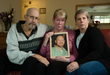 Joy and Mike Van Duinen, with their daughter, Tracey Filocamo, holding a photo of Gary.
