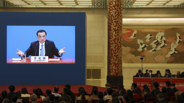 Chinese Premier Li Keqiang is displayed on a screen during a press conference after the closing session of the National People's Congress in Beijing's Great hall of the People on Friday.