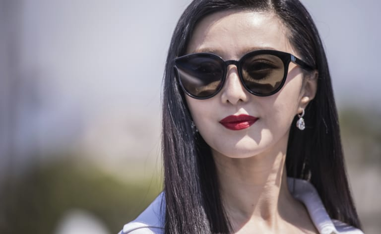 Fan BingBing poses for photographers during a photo call for the film '355' in Cannes in May.