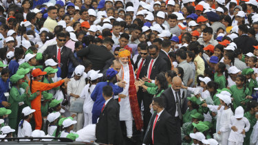 While Kashmiris are in lockdown, people in New Delhi were free to watch Prime Minister Narendra Modi (centre, wearing turban) address the nation on Independence Day.