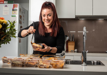 Labour of love: Camille Ruiz is cookng and giving out free meels to locals in need.
