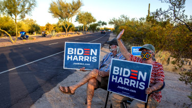 Linda and Tom Rawles, Arizona Republicans for Biden, spend four hours each day outside of their home in Carefree, Arizona, holding Biden Harris signs along the road, hoping to encourage voters to choose Joe Biden in the upcoming presidential election.