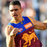 Lions edge out Cats to roar into top spot