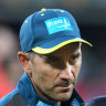 Finch speaks with coach Justin Langer.