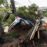 A vehicle lies half-buried in the mud after a landslide caused by heavy rains in Belo Horizonte, Brazil.