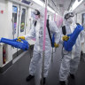 Workers disinfect a subway train in preparation for the restoration of public transport in Wuhan.