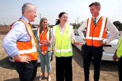 Deputy Prime Minister Michael McCormack, Minister Shannon Fentiman, Queensland Premier Annastacia Palaszczuk and Minister Mark Bailey announce infrastructure funds during a visit to a construction site in Rochedale on Wednesday.