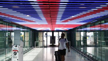 A traveller walks through Terminal 5 in London Heathrow Airport.