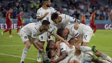 The Italians celebrate Nicolo Barella's opening goal against Belgium.