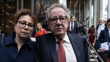 Geoffrey Rush and his wife Jane Menelaus leave the Federal Court in Sydney on Thursday.