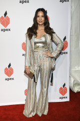 Actress Olivia Munn in the suit that was slammed by fashion blog Go Fug Yourself.