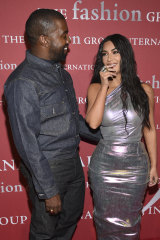 Kanye with wife Kim Kardashian at a fashion gala last week.