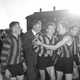 Excited players after Hawthorn's first VFL premiership.