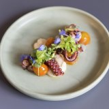 The octopus with pickled tomatoes at Frederic's is pretty as a picture.