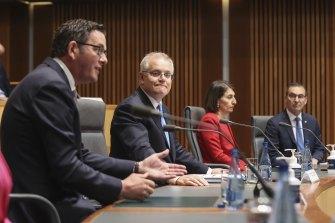 Victorian Premier Daniel Andrews alongside NSW Premier Gladys Berejiklian and Prime Minister Scott Morrison on Friday.