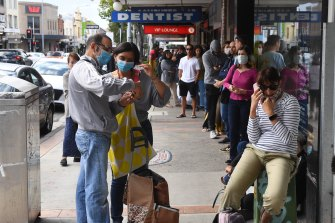 People queue down the street at Centrelink in Marrickville last year.