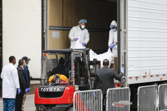 A body is loaded onto a refrigerated truck used as a temporary morgue outside Brooklyn Hospital in New York, in March.