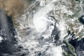 This May 19 satellite image released by NASA shows Cyclone Amphan over the Bay of Bengal in India.