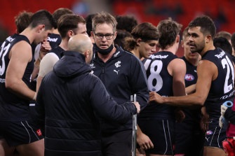 Carlton coach David Teague walks away after talking to his players during the loss to Greater Western Sydney.