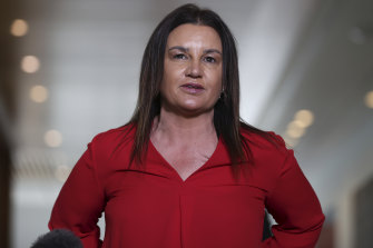 Jacqui Lambie has denied making a homophobic slur to staff at the airport.