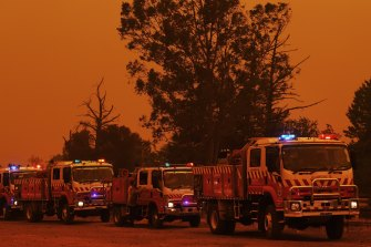 Fire trucks in Buxton as the Green Wattle Creek fire approaches the town.