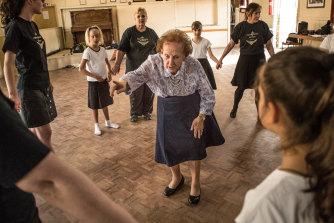 Back for 2020: Irish dancing teacher Geraldine Ryan, 89, with Warragul students including Julie Walker, at left, behind her.