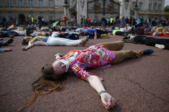 Extinction Rebellion protestors pretend to be dead outside Buckingham Palace on Saturday. The protest movement has organised a week of demonstrations across the UK.