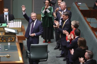 Opposition Leader Anthony Albanese is applauded by colleagues after delivering the budget reply in the House of Representatives last month.