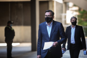 Premier Daniel Andrews and Chief Health Officer Brett Sutton arrive for a media briefing last month.