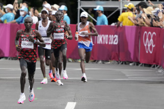Eliud Kipchoge pushes ahead of the pack on his way to winning a second Olympic gold medal in Tokyo.