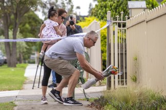 Warwick visited the scene with his wife and daughter to lay flowers on Friday morning.