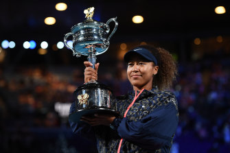 Naomi Osaka with the trophy after her victory over Jennifer Brady in the women's final.