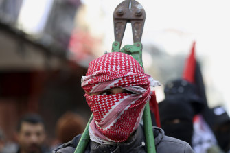A masked member of Hamas at a protest against the Mid East plan announced by US President Donald Trump, in Gaza City, last month.
