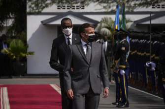French President Emmanuel Macron  and Rwandan President Paul Kagame inspect a guard of honour  in Kigali on Thursday.