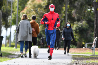 Socially distanced and double-masked ... jogger Stuart Tyson, as Spider-Man, has brought joy to Melburnians in lockdown.
