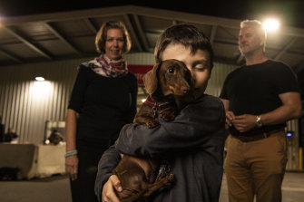 Dachshund Pip reunited at Sydney Airport with the Eilbeck family.
