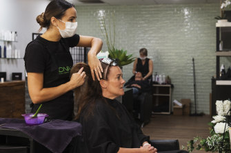 Joanne Sultana works on Sonia Korthout at Union Jacks Hair salon in Frenchs Forest on Wednesday.
