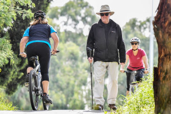Joe Meakin passes cyclists on his daily walk in Eltham.