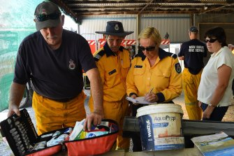 RFS Rainbow Flat firefighters replenish their medical kit.