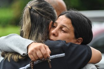 Leila Abdallah being comforted on Monday morning before addressing the media.
