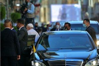 Pope Francis, center left, arrives to meet Shiite Muslim leader, Grand Ayatollah Ali al-Sistani in Najaf.