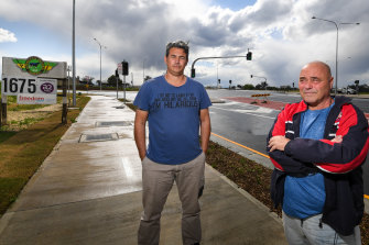 Small landowners Paul Coyto and Peter Srzich at the new traffic lights in front of the Leppington Pastoral Company's  main entrance.