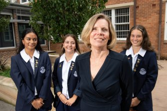 High school teacher Sandra Moore has been well since being treated with a breakthrough melanoma treatment three years ago. With her are Burwood Girls High School students (l-r) Arisha Sahay, Lili Franco and Alyssa Broughton.