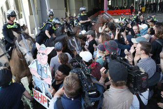 Police clash with protesters outside the IMARC conference in Melbourne.