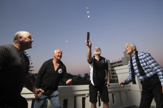 (From left) Sean Dry and friends Tim Reilly, Steve Woodley and Phil Nicol look forward to playing two-up at their pub in Freshwater on Anzac Day.