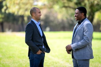 Alex Moreno, left, was a senior executive at Accenture when he met 'Dozie' Ojoho, who was highly qualified but selling cars as he could not get work at his skill level despite hundreds of job applications.